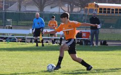 Navigation to Story: Soccer Team Gains Experience