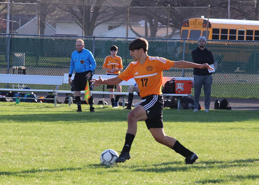 Ethan Grawe dribbles the ball toward Solon's goal.