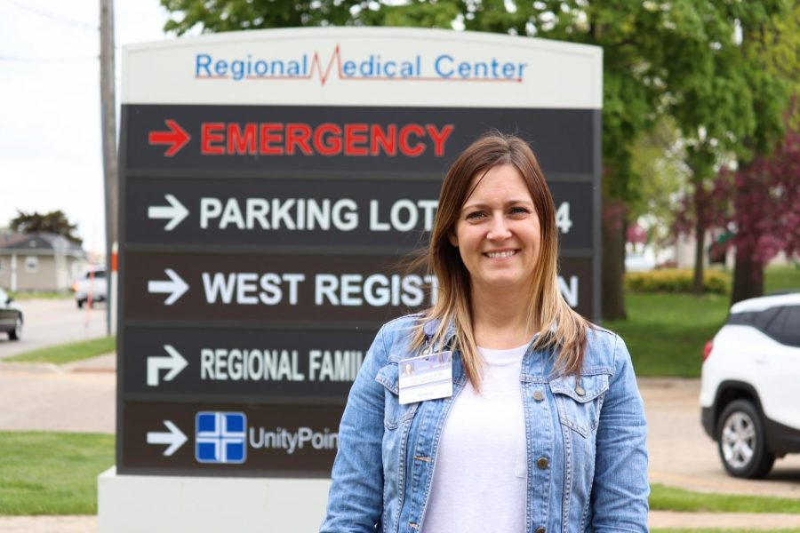 Charity Loecke, Delaware County Public Health nurse, stands in front of the Regional Medical Center.