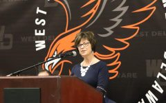 Superintendent Dr. Kristen Rickey welcomes everyone to commencement.