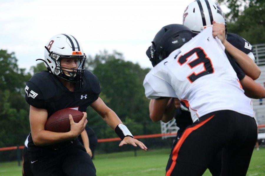 Freshman Brett Yonkovic runs a play against the Solon Spartans. The freshmen beat Solon, 32-0.
