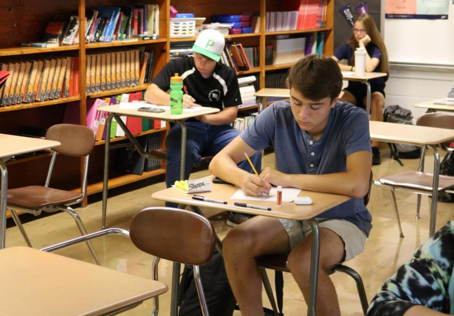 In Journalism during the first week of school, Grant Menard (12) learns about photo composition.